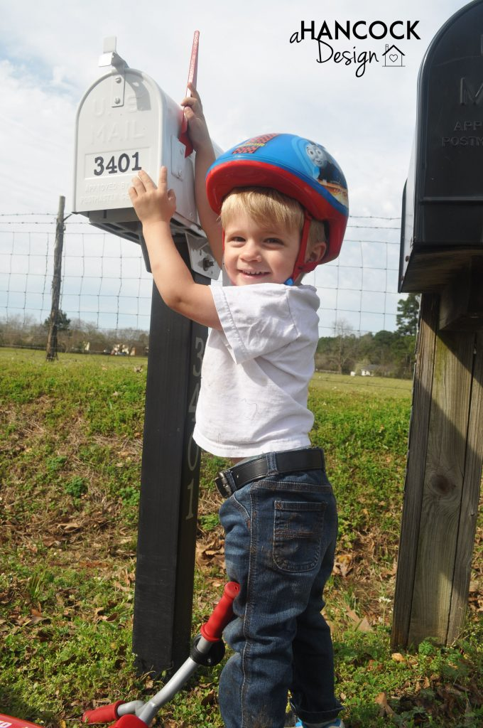 Cute kid by mailbox