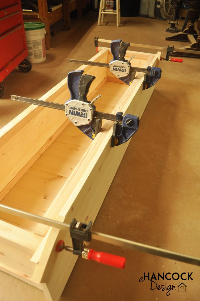 Clamps holding top on bench seat footboard
