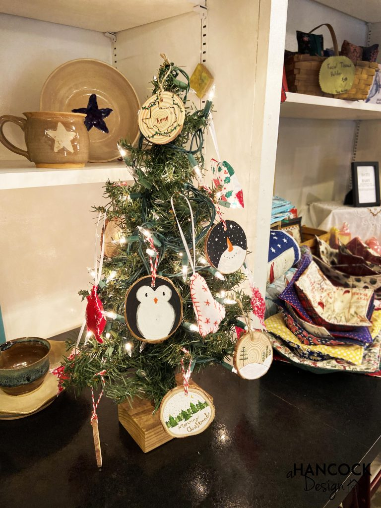 Wood Slice Ornaments hanging on tree