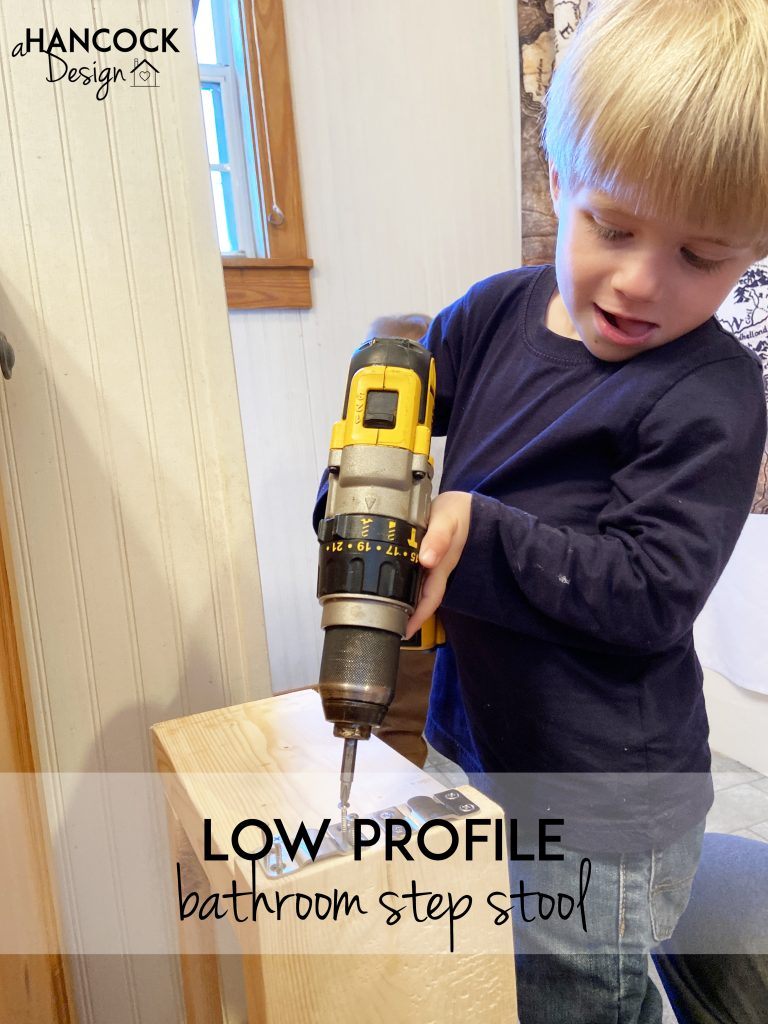 little boy helping drill